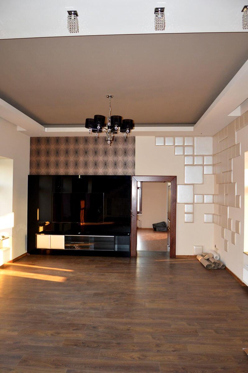 Egyedi nappali bútor gyártás üveghátlappal, fekete színben, rejtett LED világítással