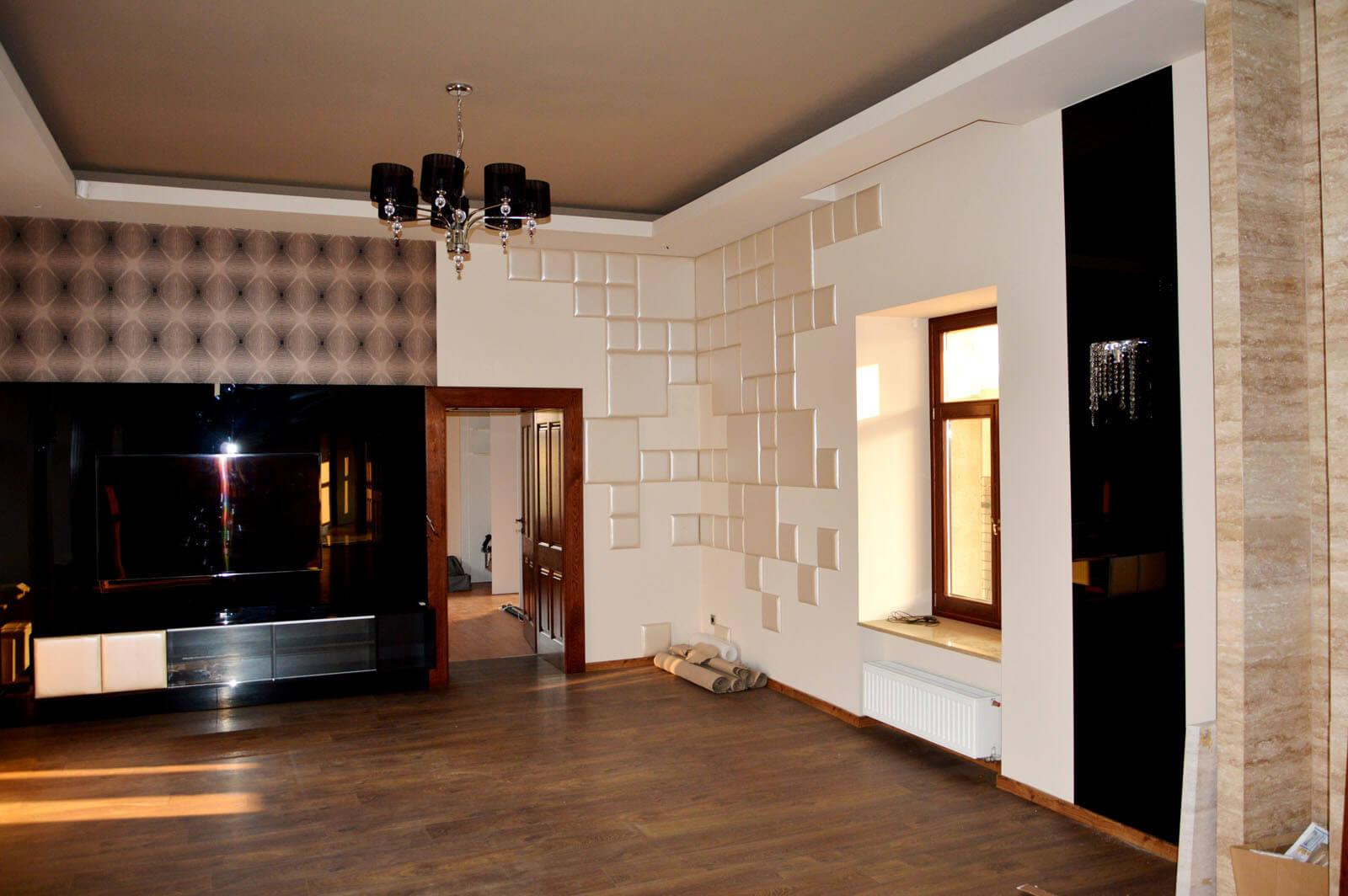 Egyedi nappali bútor készítés fekete üvegburkolattal, rejtett LED világítással